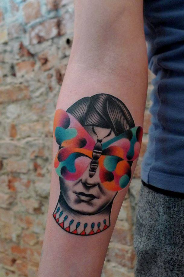 Abstract Man Face With Butterfly Tattoo On Right Forearm