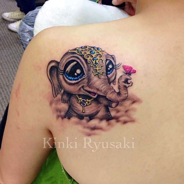971670a71 Attractive Dumbo Tattoo On Women Left Back Shoulder
