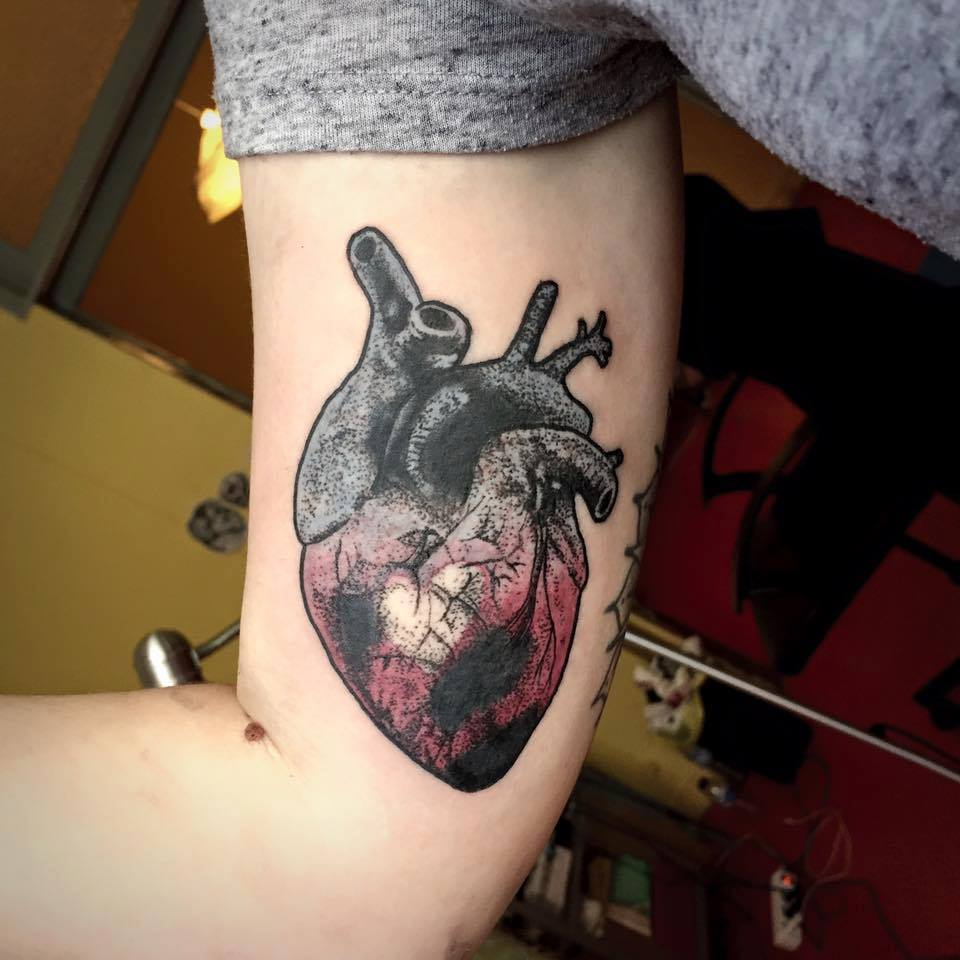 Attractive Real Heart Tattoo On Right Bicep