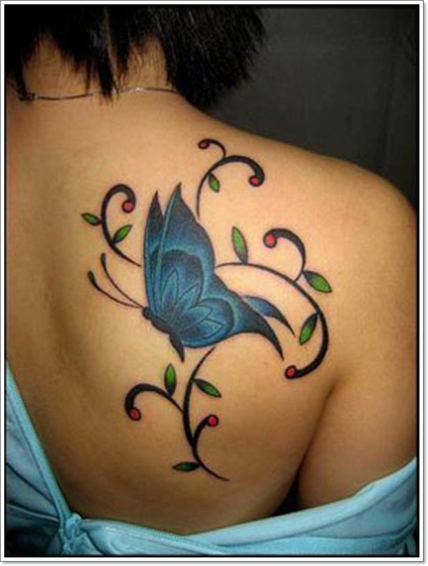 c21c9d7a1a822 Black And Blue Butterfly Tattoo On Girl Back Shoulder