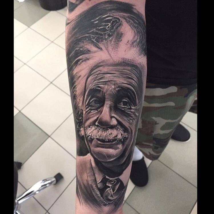 Black And Grey Albert Einstein Tattoo On Right Forearm