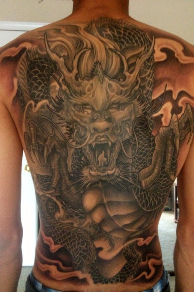 black and grey dragon tattoo on man full back. Black Bedroom Furniture Sets. Home Design Ideas