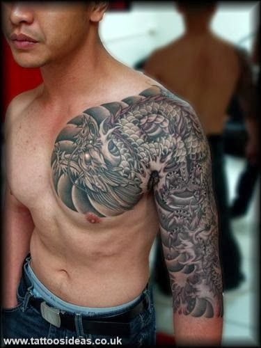 Black And Grey Dragon Tattoo On Man Left Half Sleeve And Chest