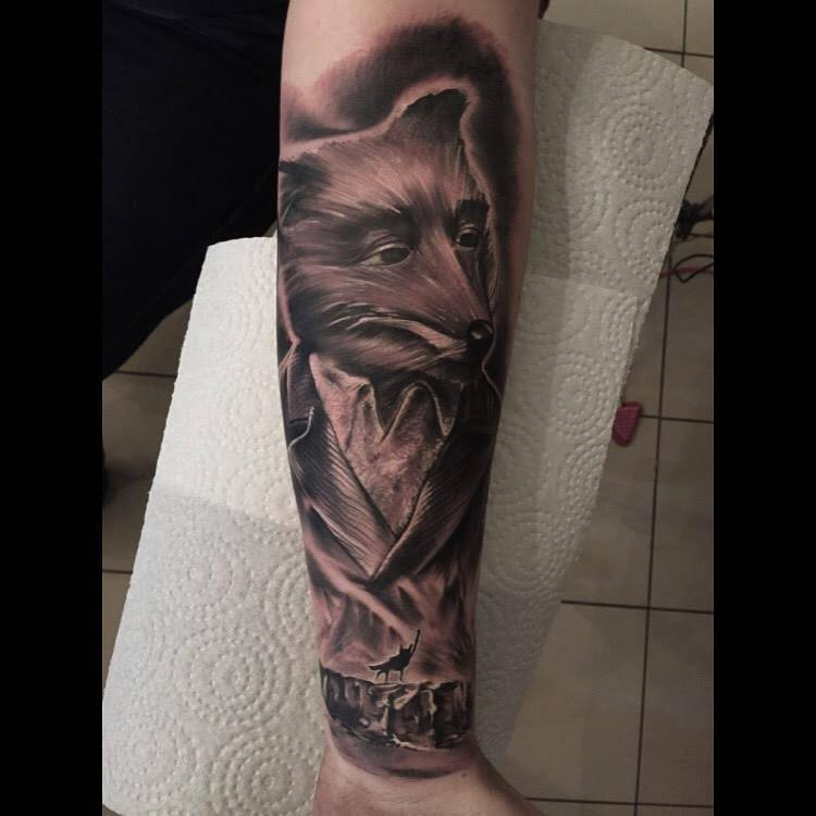 Black And Grey Gentleman Fox Tattoo On Forearm