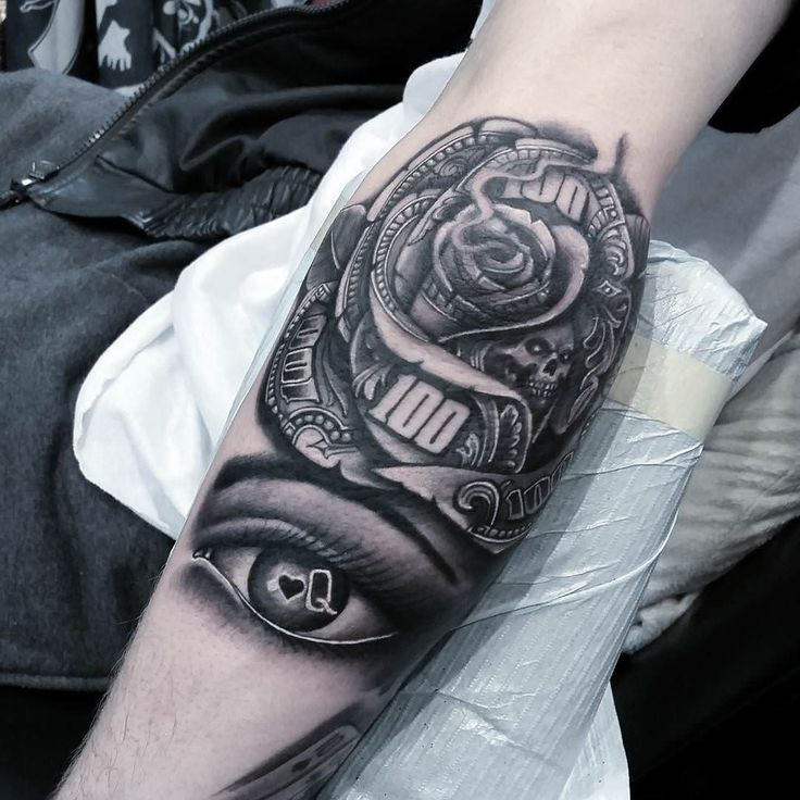 black and grey money rose with skull and eye tattoo on forearm. Black Bedroom Furniture Sets. Home Design Ideas