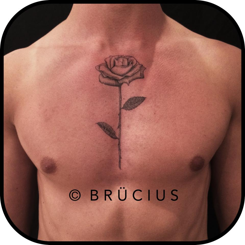 Black And Grey Rose Tattoo On Man Chest
