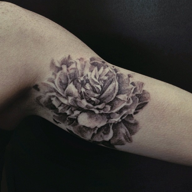 Black And White Peony Flower Tattoo On Bicep