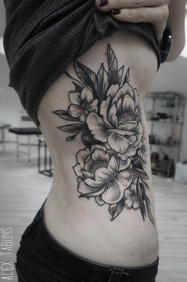 Black And White Peony Flowers Tattoo On Right Side Rib