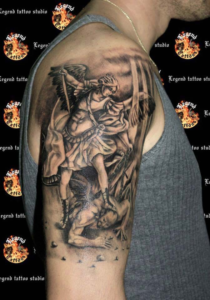 Black Ink Archangel Michael Tattoo On Man Right Half Sleeve