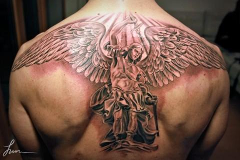 39 nice archangel michael tattoos on back. Black Bedroom Furniture Sets. Home Design Ideas