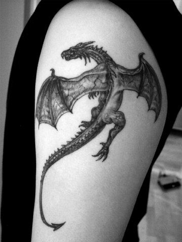 Black ink dragon tattoo on left half sleeve for Little dragon tattoo