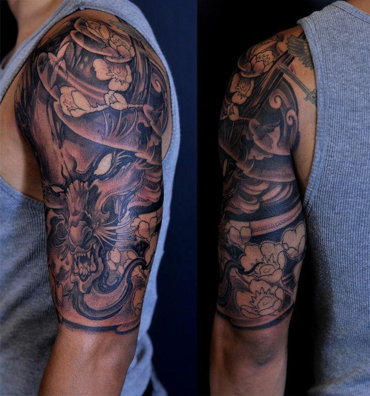 239e725f1 Black Ink Dragon With Flowers Tattoo On Man Left Half Sleeve