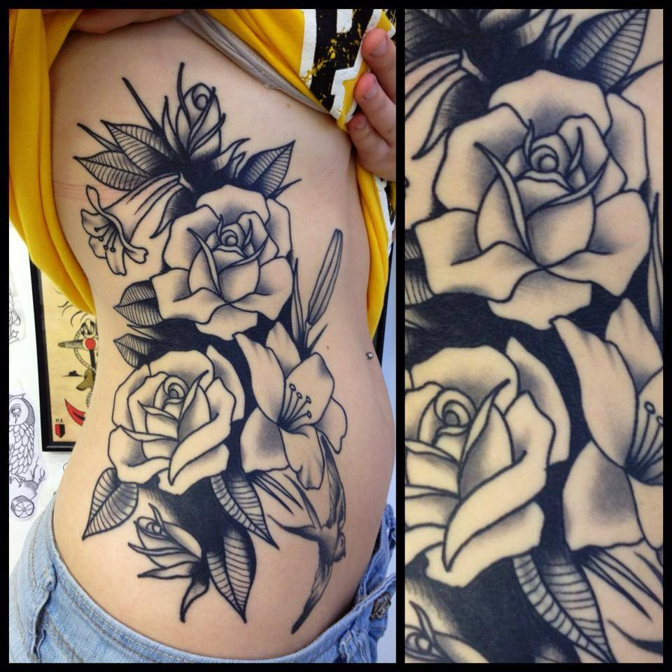Black Ink Flower With Flying Bird Tattoo On Right Side Rib