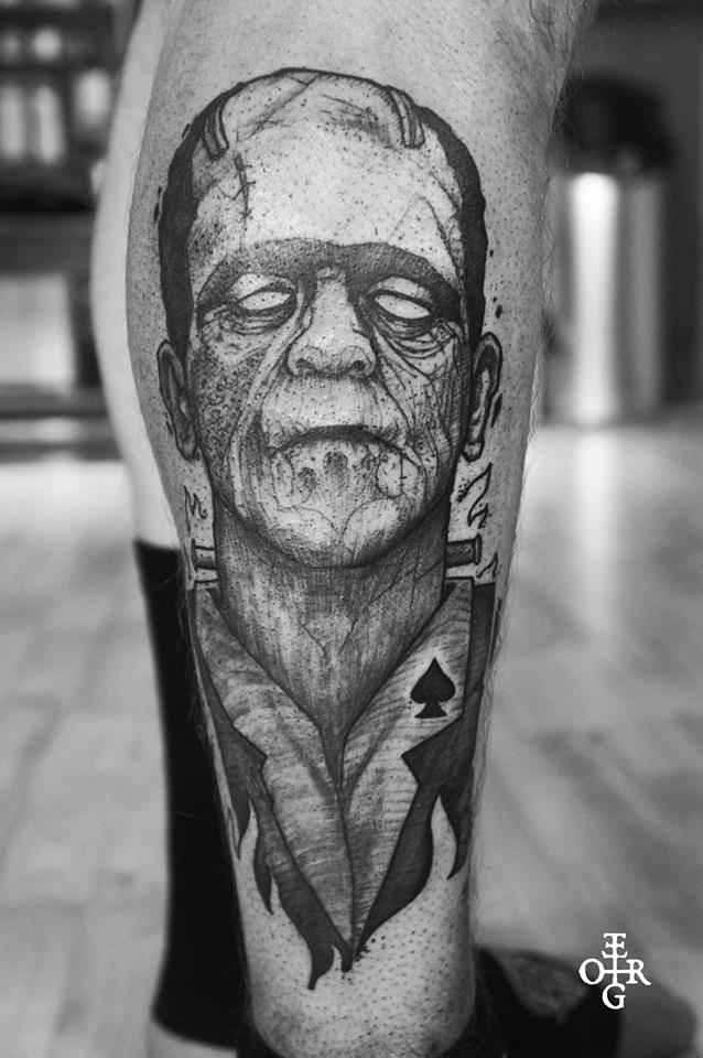 Black Ink Frankenstein Tattoo On Right Leg Calf