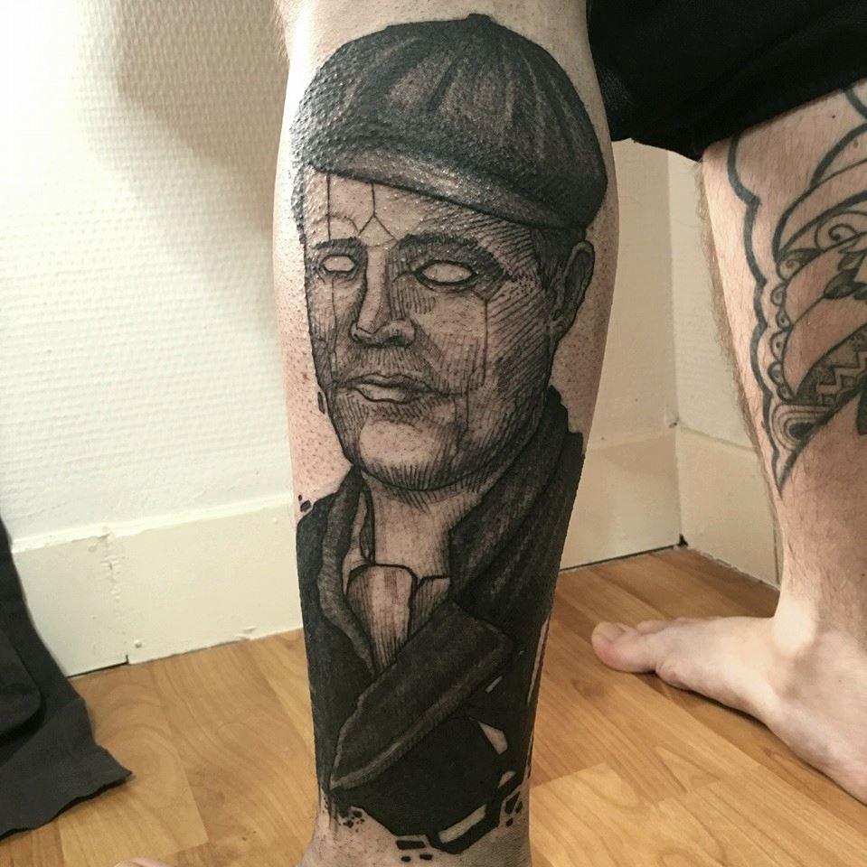 Black Ink Man Head Tattoo On Left Leg