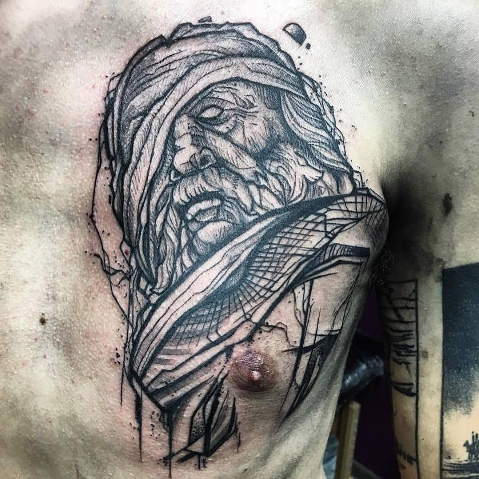 Black Ink Old Man Head Tattoo On Man Left Chest