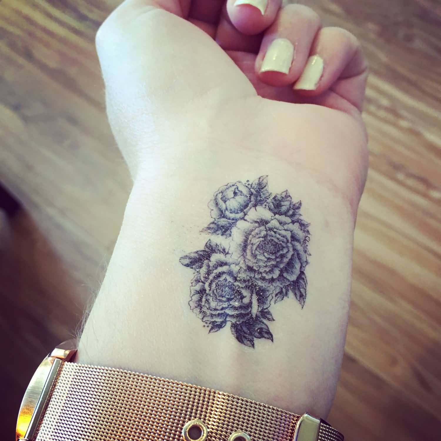 Black ink tattoos for girls - Black Ink Peony Flowers Tattoo On Girl Left Wrist