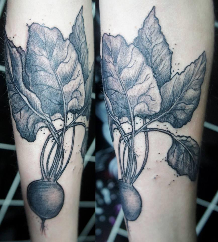 Black Ink Radish Tattoo On Sleeve