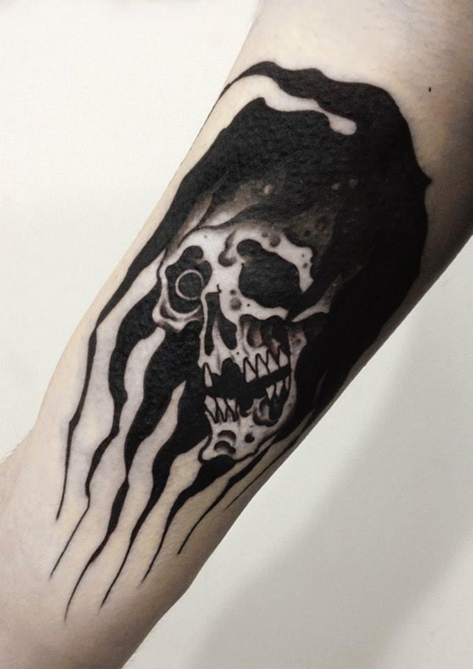 Black Ink Skull Tattoo On Bicep