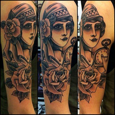 Black ink women head with rose tattoo on right half sleeve for Chris martin tattoos