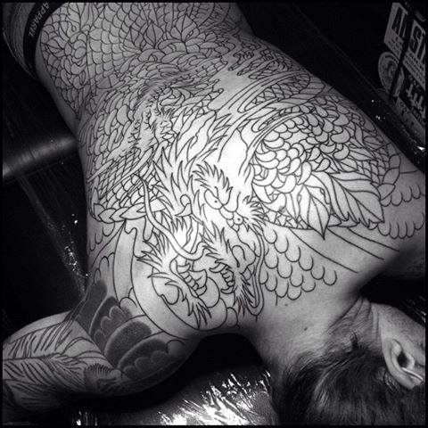 Black Outline Dragon Tattoo On Man Full Back