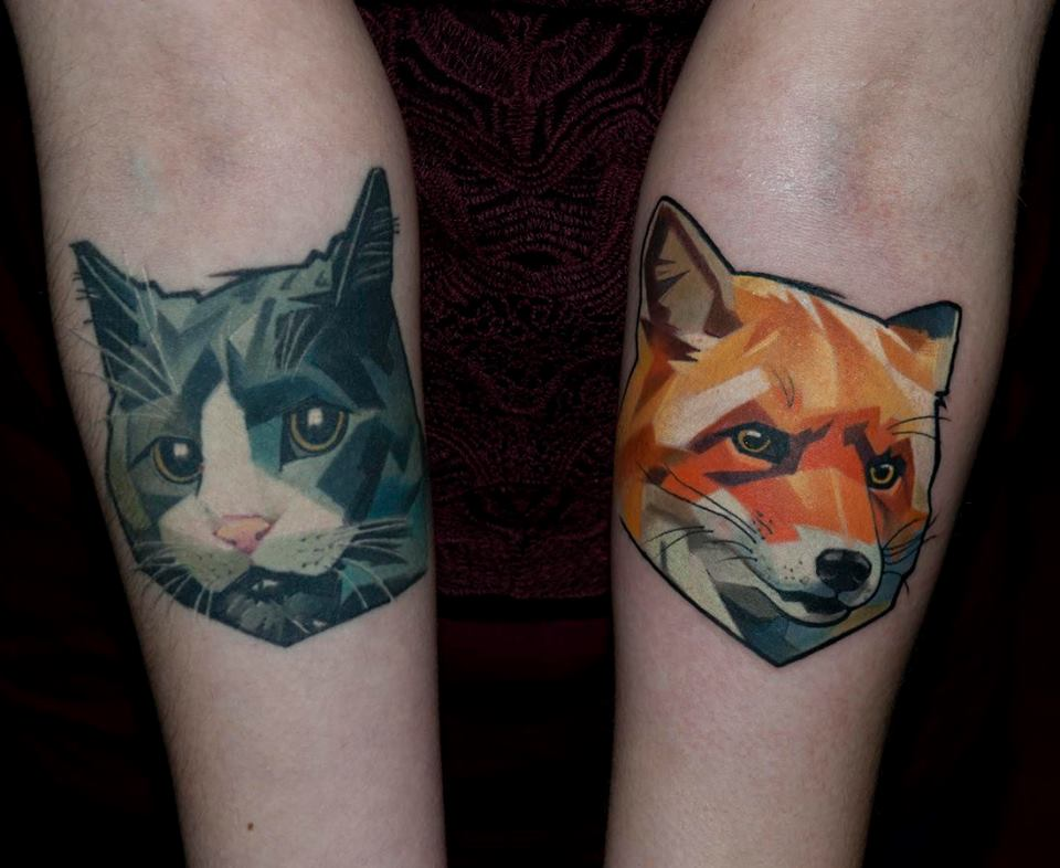 Cat And Fox Tattoo On Both Forearm
