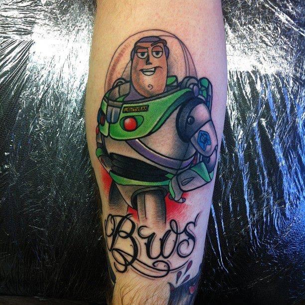 Cartoon tattoos for Chris martin tattoos