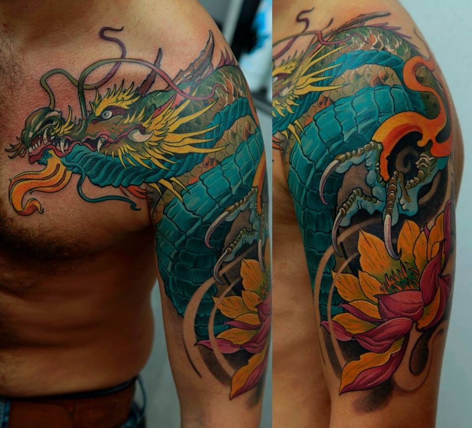 Colorful Dragon With Flower Tattoo On Man Left Half Sleeve