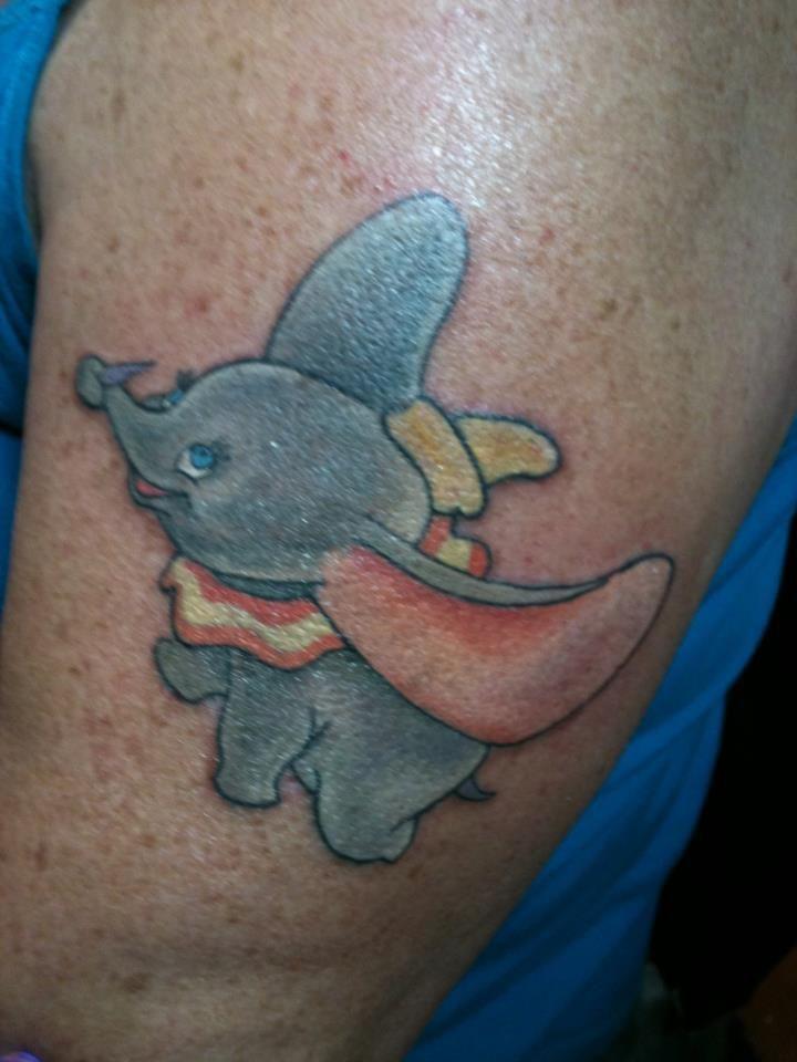 Cool Flying Dumbo Tattoo On Left Half Sleeve