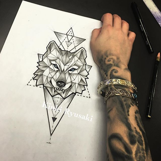 Geometric Wolf Head Tattoo Design