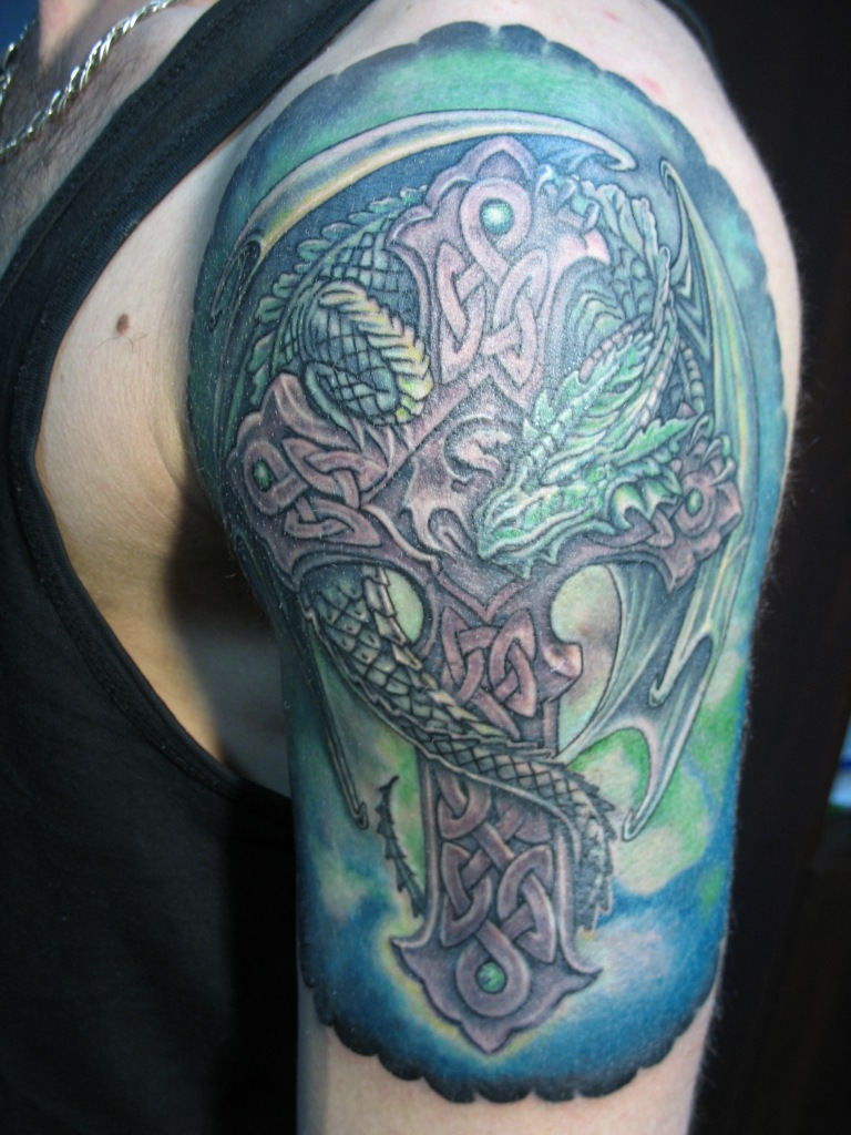 Green Ink Dragon With Celtic Cross Tattoo On Left Half Sleeve