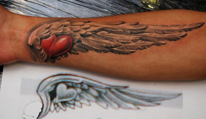 Heart With Wing Tattoo On Forearm By Dmitriy Samohin