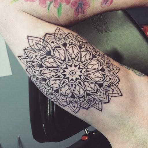inner bicep mandala tattoo