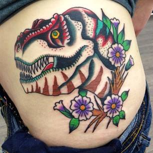 Traditional Dinosaur With Flowers Tattoo On Left Side Rib