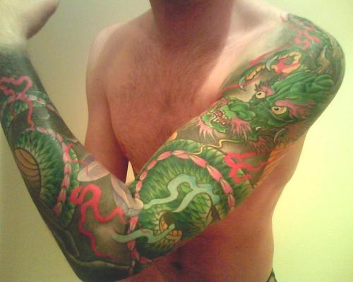 traditional dragon wrap around tattoo on man left full sleeve. Black Bedroom Furniture Sets. Home Design Ideas