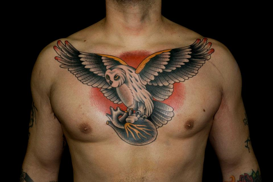 Traditional Flying Owl With Real Heart Tattoo On Man Chest