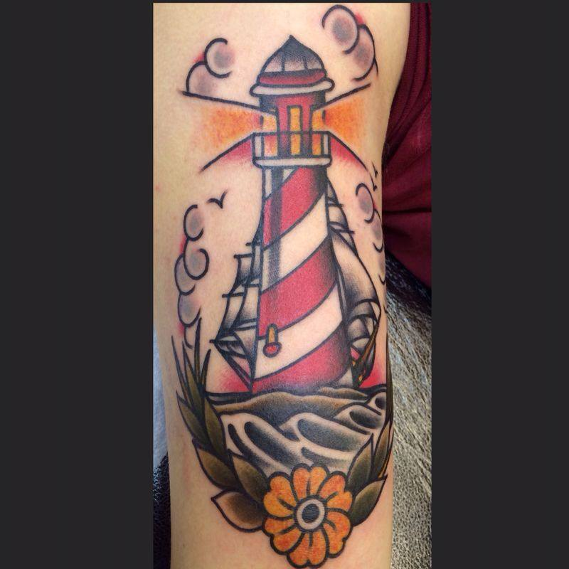 8d6cbc4e5 Traditional Lighthouse With Flower Tattoo On Right Sleeve