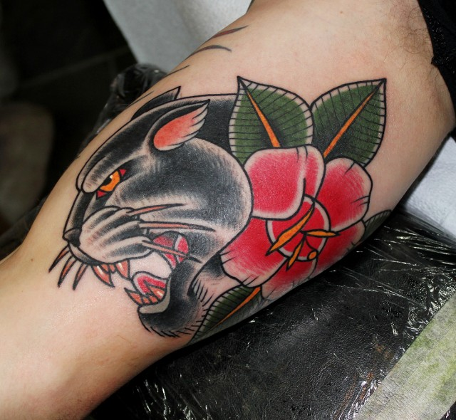 Traditional panther head with rose tattoo on half sleeve for Traditional panther tattoo