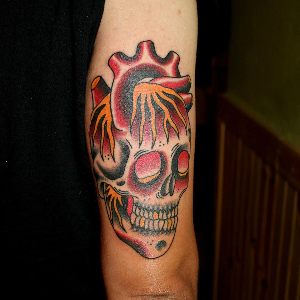 Traditional Real Heart Skull Tattoo On Half Sleeve