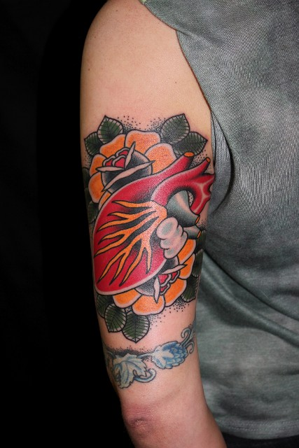 Traditional Real Heart With Flowers Tattoo On Left Half Sleeve
