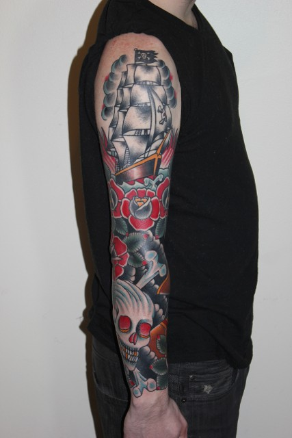 Traditional Ship With Flower And Danger Skull Tattoo On Right Full Sleeve