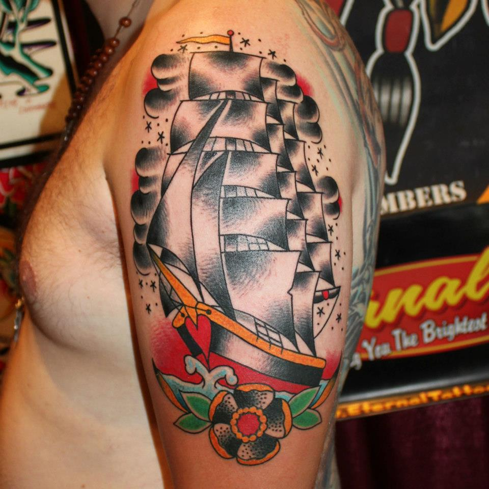 Traditional Ship With Flower Tattoo On Man Left Half Sleeve