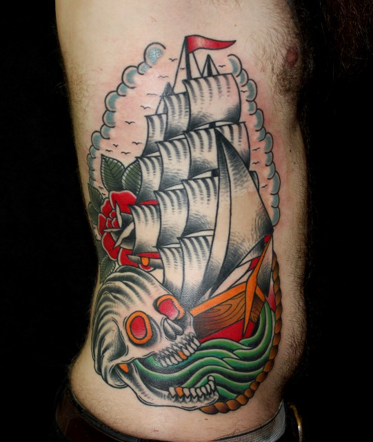 Traditional Skull With Ship Tattoo On Man Right Side Rib