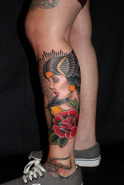 Traditional Women Face With Rose Tattoo On Left Leg Calf