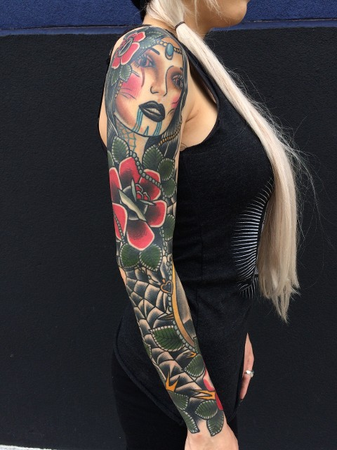 Traditional Women Face With Rose Tattoo On Right Full Sleeve