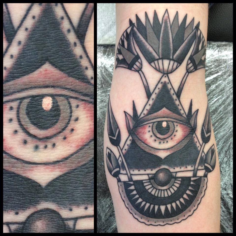 Unique Black Ink Illuminati Eye Tattoo Design For Forearm