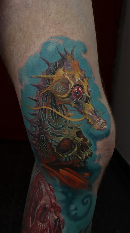 Unique Seahorse With Skull Tattoo On Knee