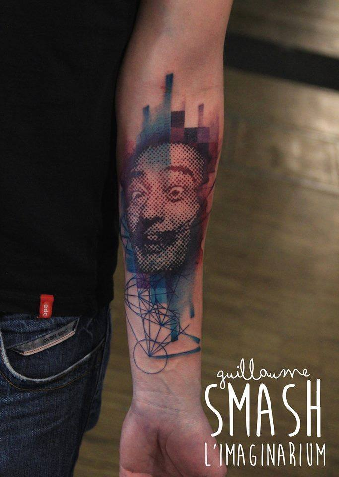 Wonderful Abstract Face Tattoo On Left Forearm