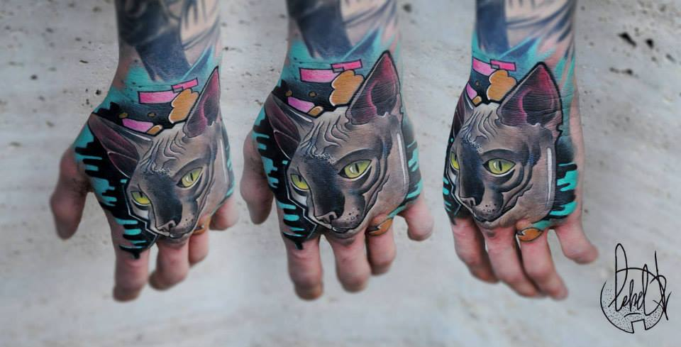 Wonderful Cat Face Tattoo On Left Hand