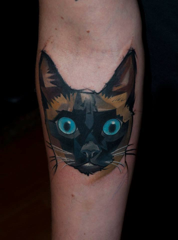 Wonderful Cat Head Tattoo On Forearm
